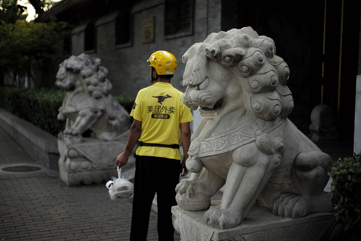 A Meituan worker delivers food to a residence in Beijing on Aug. 31. Photo: VCG