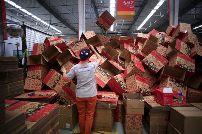 An employee works at a Tmall logistic center in Suzhou, Jiangsu province, in October 2015. Photo: VCG