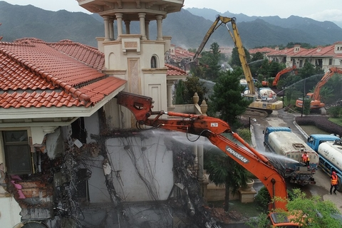 A construction vehicle tears into a home. Photo: VCG