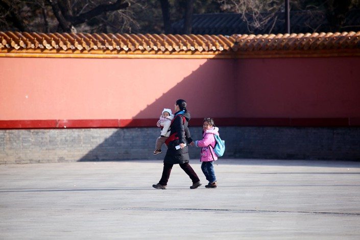 A mother takes her two children to a park in the northeastern city of  Shenyang in February 2016. Photo: IC