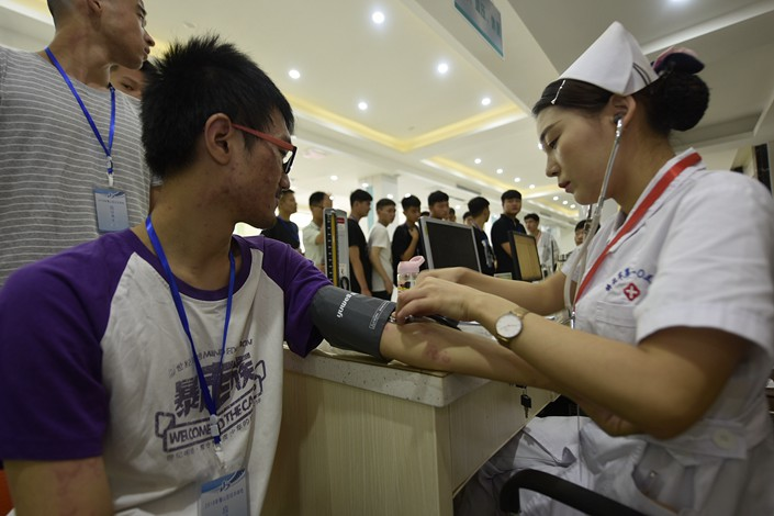 Physical checkups are conducted at a medical examination center in Hefei, Anhui province, on Aug. 1. Photo: VCG