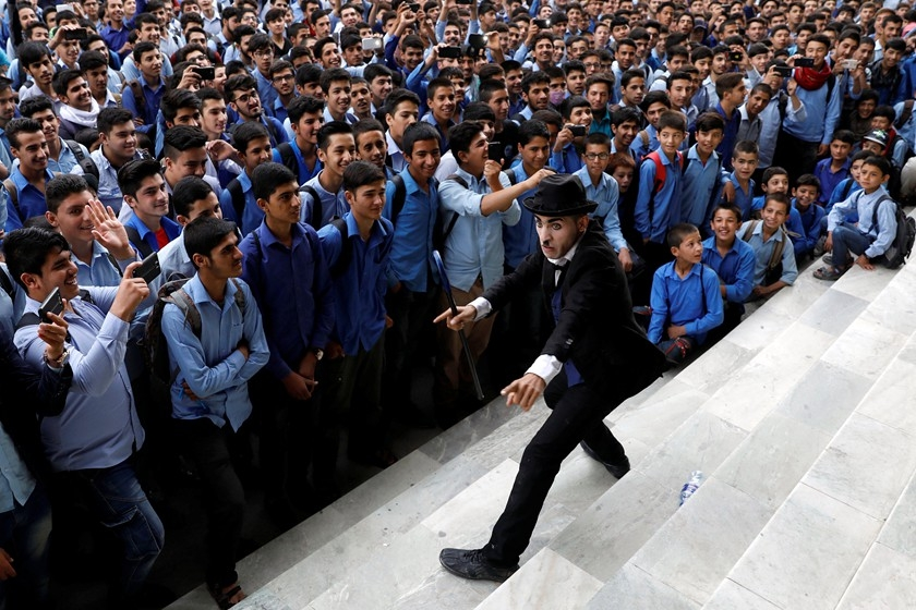 """Afghanistan's Charlie Chaplin,"" Karim Asir, 25, performs at a school in Kabul, Afghanistan, on Sept. 5. Photo: VCG_'Afghanistan's Charlie Chaplin'Tramps Through Country"