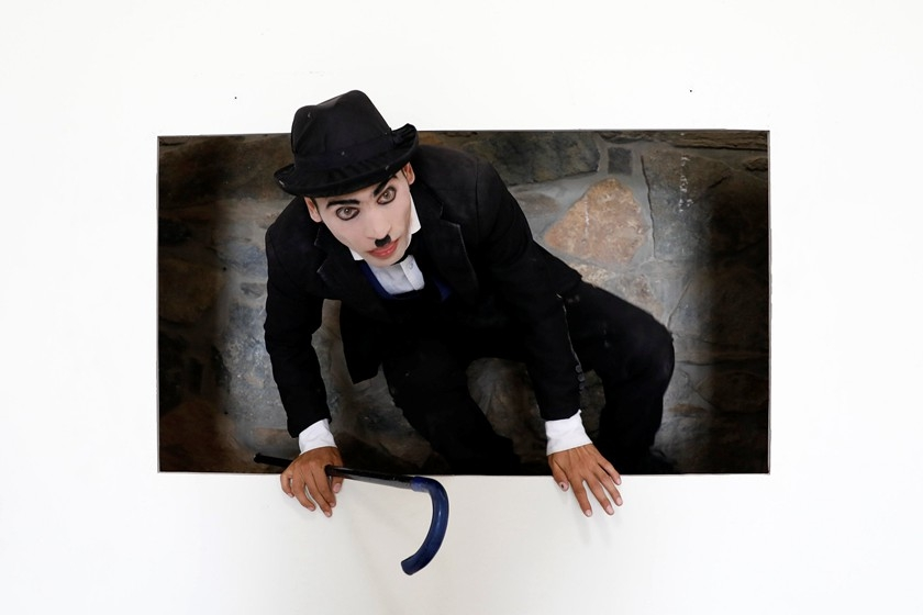 """Afghanistan's Charlie Chaplin,"" 25-year-old Karim Asir, exercises during his rehearsal in Kabul, Afghanistan, on Aug. 29. Photo: VCG_'Afghanistan's Charlie Chaplin'Tramps Through Country"