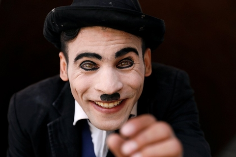"""Afghanistan's Charlie Chaplin,"" Karim Asir, 25, smiles during his rehearsal in Kabul, Afghanistan, on Aug. 29. Photo: VCG"