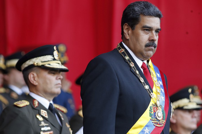 Venezuela's President Nicolas Maduro watches a military parade on May 24 in the capital of Caracas. Photo: IC