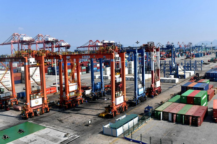 Cargo gets readied for export at the port of Xiamen in eastern China on Friday. Photo: VCG