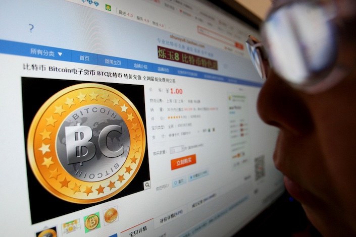 Chinese regulators warn risks of cryptocurrency-related financial fraud. Photo: VCG