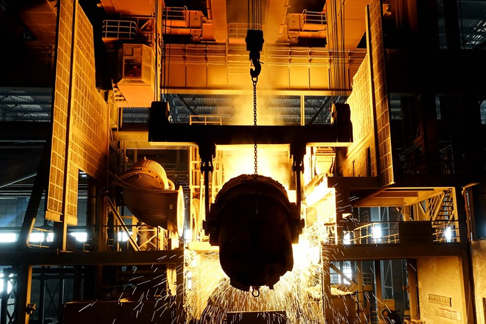 A crane operator pours molten steel in a Dalian Special Steel Co. Ltd. steel mill on Feb. 12. Photo: VCG
