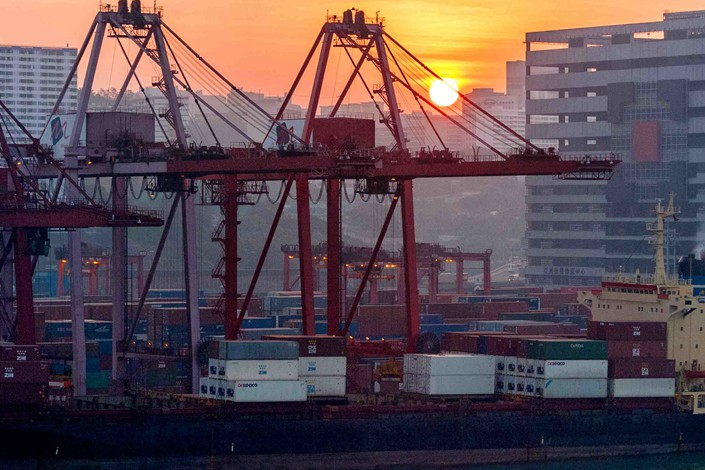 Cranes load cargo containers at a container terminal at the Port of Hong Kong on Nov. 4. Photo: IC