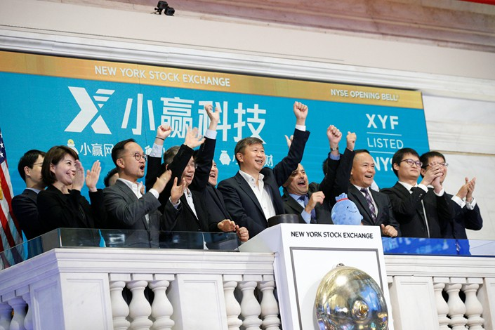 Chinese peer-to-peer lender X Financial begins trading on the New York Stock Exchange at the opening bell on Wednesday. Photo: VCG