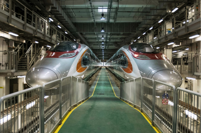 Two of the trains that will be used on the Guangzhou-Shenzhen-Hong Kong Express Rail Link stand in Hong Kong on Aug. 2, 2017. Photo: VCG