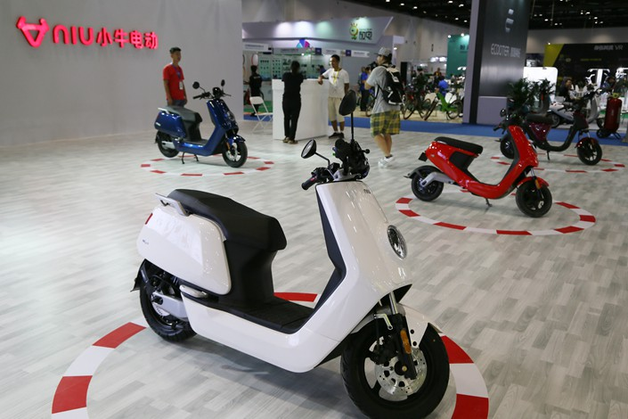 Niu Technologies Group Ltd. electric scooters are displayed at the Beijing International Bicycle Exhibition in July 2017. Photo: VCG