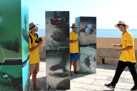 Tourists at Cascais, Portugal, look at a photo exhibit of the shipwreck. Photo: VCG