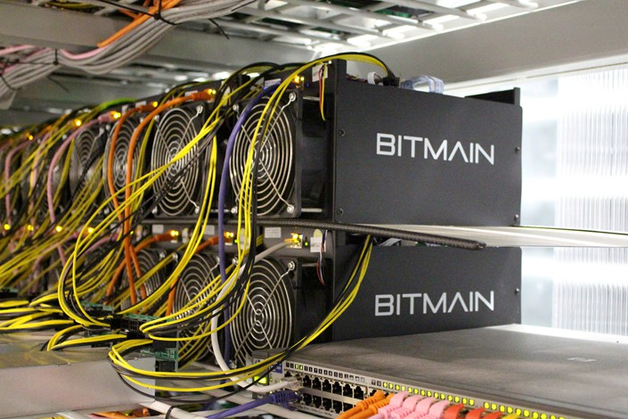 Bitcoin-mining computers, made by Bitmain Technologies Ltd., are seen at Bitmain's crypto mining farm near Keflavik, Iceland, in June 2016. Photo: VCG