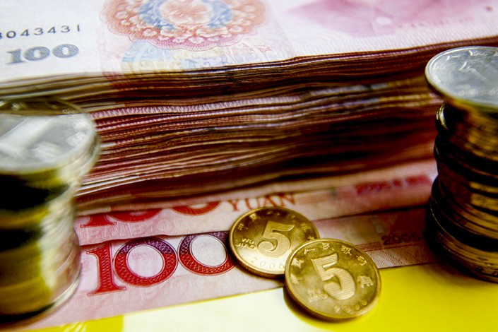 China's central bank announced on Sunday that effective Oct. 15, it will cut the amount of cash that lenders must set aside as reserves. Photo: VCG