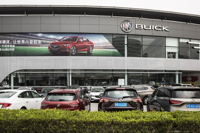General Motors Co.'s Buick vehicles are displayed outside a car dealership in Shanghai on July 8. Photo: VCG
