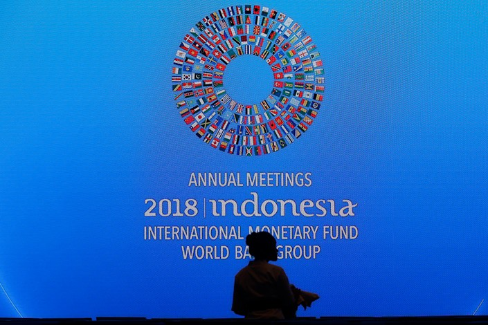 A banner from the annual joint meetings of the International Monetary Fund and World Bank is seen in a conference room in Bali, Indonesia, on Monday. Photo: IC