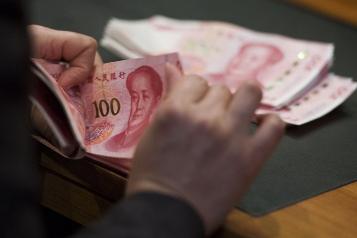 China's total social financing report shows stronger demand from consumers than companies. Photo: Bloomberg