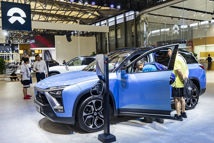 Automaker NIO showcases its electric vehicles at an auto show in Shanghai on Sept. 28. Photo: VCG