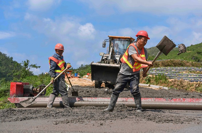 Workers build a road in Southwest China's Guizhou province on May 14. Photo: VCG