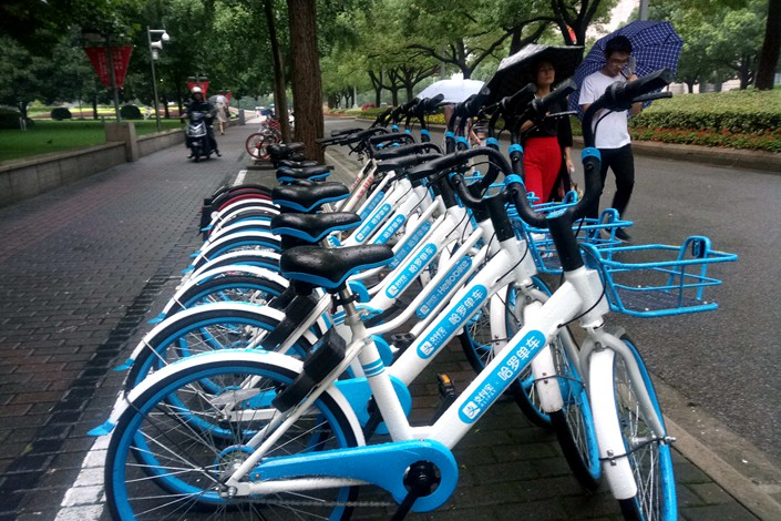 Bicycles of Chinese bike-sharing service Hellobike are seen on a Shanghai street on July 5. Photo: IC