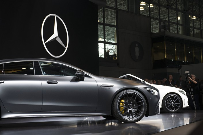 Daimler showcases its Mercedes-Benz AMG GT 63 S, left, during the 2018 New York International Auto Show in the U.S. on March 28. Photo: VCG
