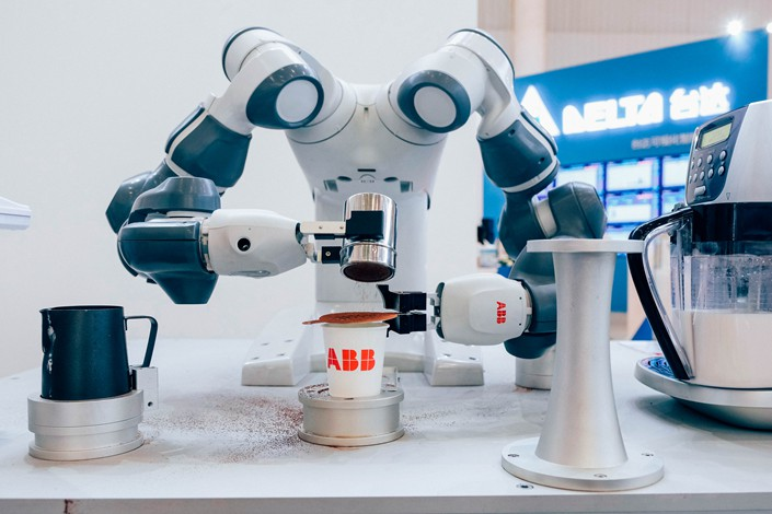 An ABB Ltd. robot makes coffee during the Industrial Automation and Robotics Show in Wuhan, Hubei province, on June 5. Photo: IC