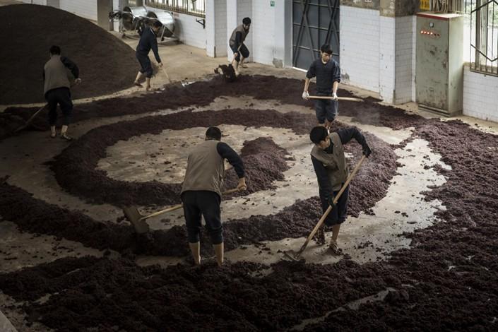 Baijiu production inside China's biggest distiller Kweichow Moutai. Photo: Bloomberg
