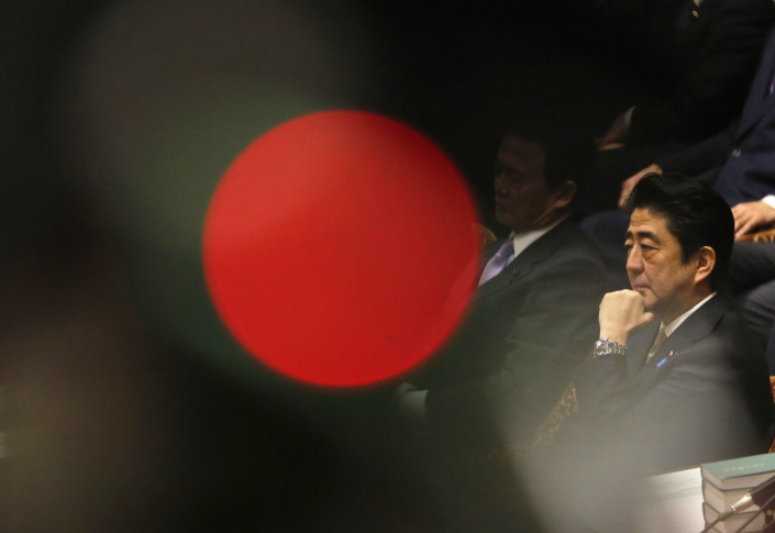 Japan's Prime Minister Shinzo Abe attends a lower house budget committee session at the parliament in Tokyo Feb. 13, 2014. The red spot is from a TV camera's lamp. Photo: VCG