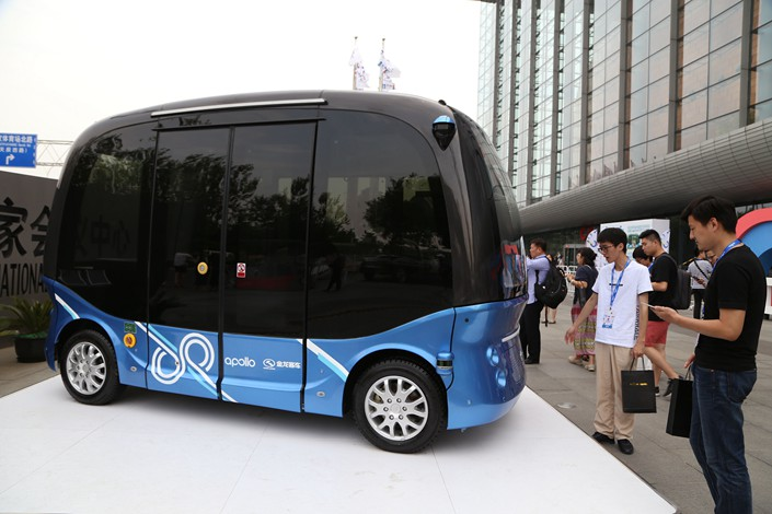 Apolong, the world's first Level-4 self-driving bus, is unveiled at Baidu Inc.'s artificial-intellegence developer conference in Beijing on July 4. Photo: VCG