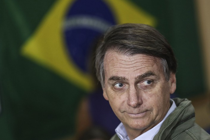Jair Bolsonaro, the right-wing candidate of the Social Liberal Party who won Brazil's presidential election, votes during runoff elections in Rio de Janeiro on Sunday. Photo: VCG