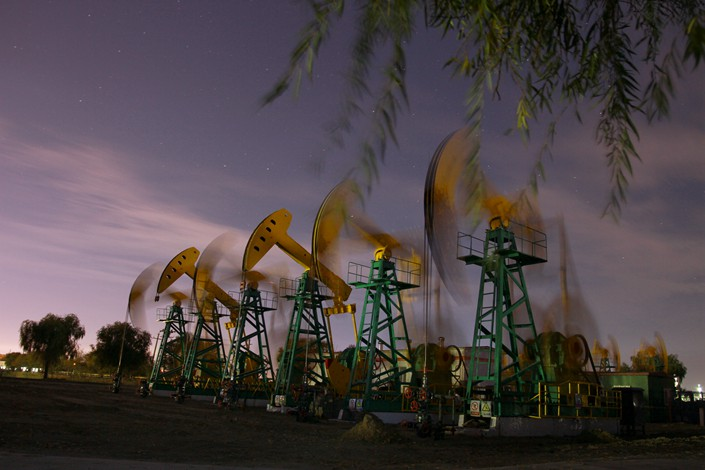Oil is pumped at an oil field in Daqing, Heilongjiang province on Oct. 11. Photo: IC