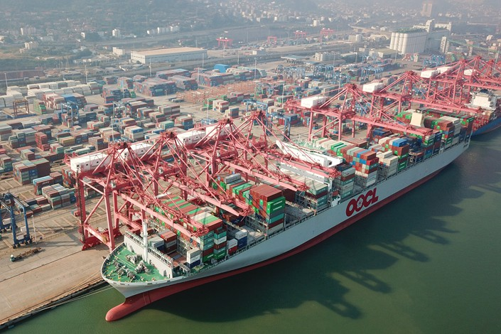 Cargo gets loaded and unloaded on Oct. 12 at a port container terminal in East China's Jiangsu province. Photo: VCG
