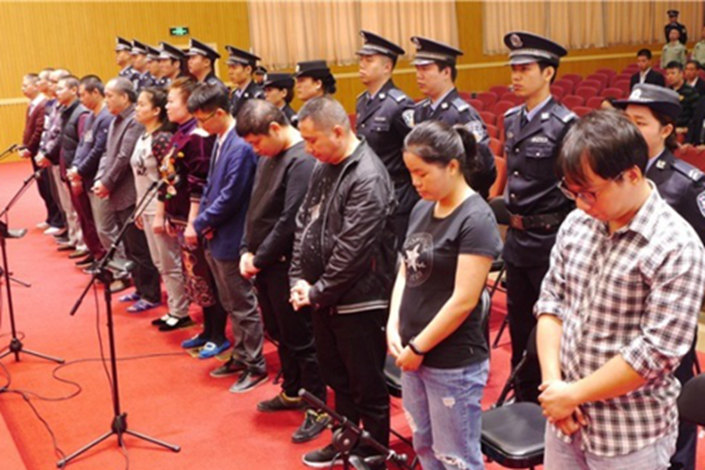 Thirteen defendants who appeared Friday in the Intermediate People's Court in Liuzhou, the Guangxi Zhuang autonmous region, received sentences ranging from 18 months to 10½ years in prison in a fraud case involving the attempted murder of a banker and $6.1 billion in swindled bank funds. Photo: Liuzhou Intermediate People's Court
