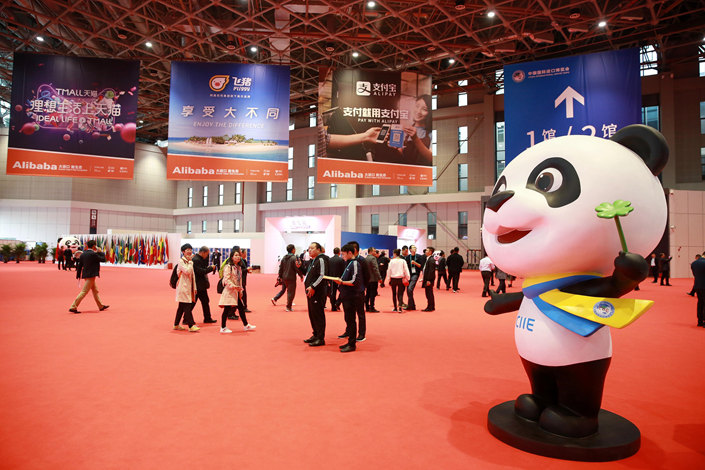 Ads for Alibaba Group Holding Ltd. are seen at the site of the first Chinese International Import Expo in Shanghai on Monday. Photo: VCG