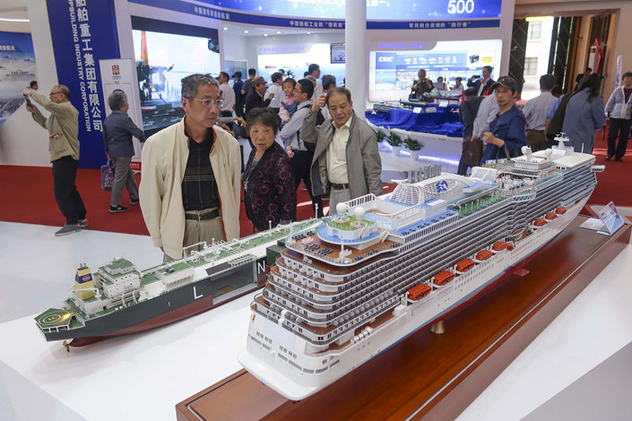 Attendees at the China Independent Brand Expo check out a model of a luxury cruise ship in Shanghai on May 10. Photo: VCG