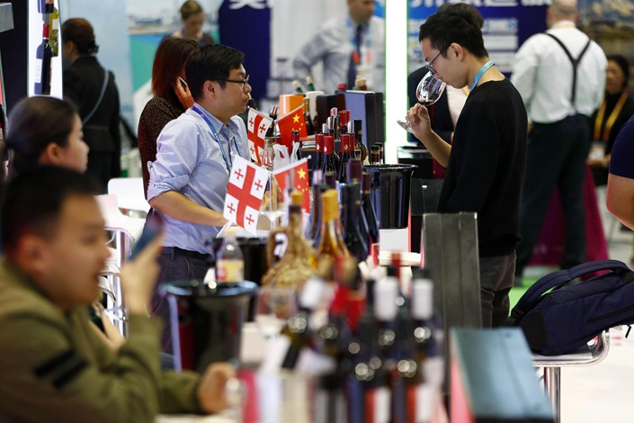 Attendees of the China International Import Expo in Shanghai sample Georgian red wine on Tuesday. Photo: VCG