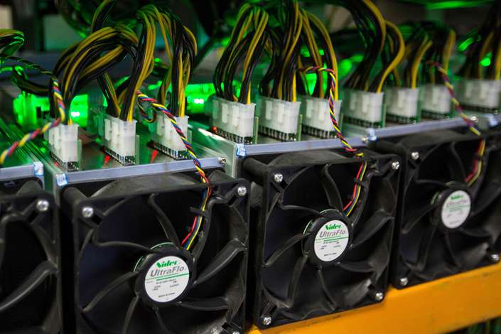 A high school principal and vice principal in Hunan province have been sacked for running up their school's electric bill by cryptocurrency mining. Photo: VCG