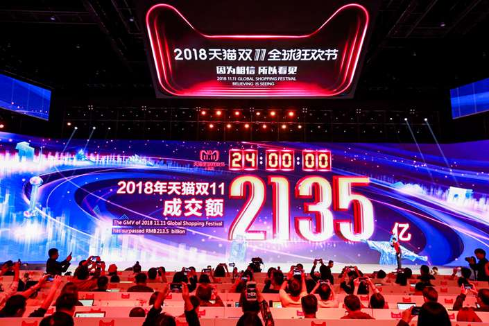 A giant screen shows the total gross merchandise volume from online shopping on e-commerce giant Alibaba's marketplaces Tmall and Taobao on Sunday. Photo: VCG