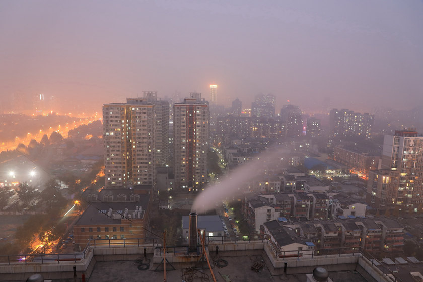"Beijing's municipal air pollution emergency response office issued a ""yellow alert"" for smog on Wednesday, even as a chimney continued to release pollution into the air. Visibility fell to 500 meters (1,640 feet) or less, and the Air Quality Index surpassed 300. Photo: VCG_Gallery: Heavy Smog Chokes Beijing as City Issues 'Yellow Alert'"