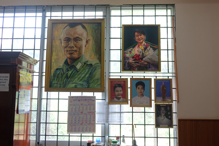 Portraits of National League for Democracy leaders on display at the party's headquarters in Yangon, Myanmar. Photo: Pei-hua Yu/Caixin Globus