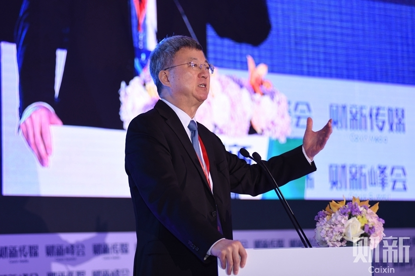 Former IMF Deputy Managing Director Zhu Min attends the 9th Caixin Summit in Beijing on Nov. 18. Photo: Chen Weixi, Ding Gang, Cai Yingli, Xu Yue/Caixin