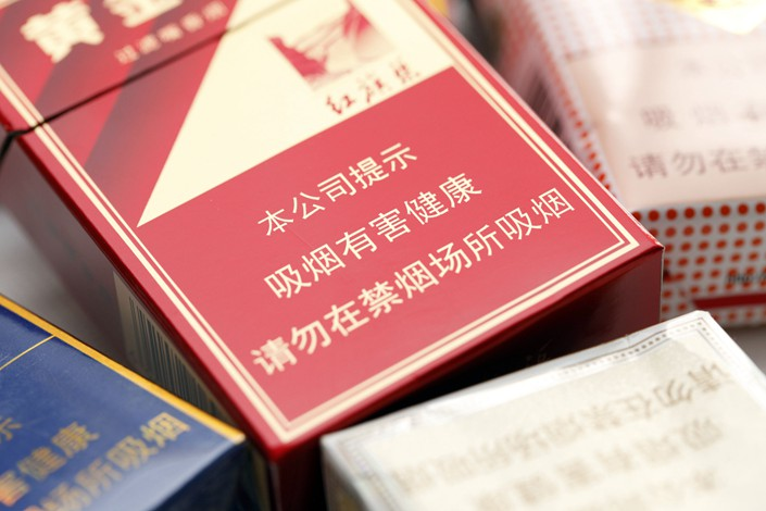 """Smoking is harmful to health, please do not smoke in non-smoking places"" is seen printed on a cigarette box in May 2017. Photo: VCG"