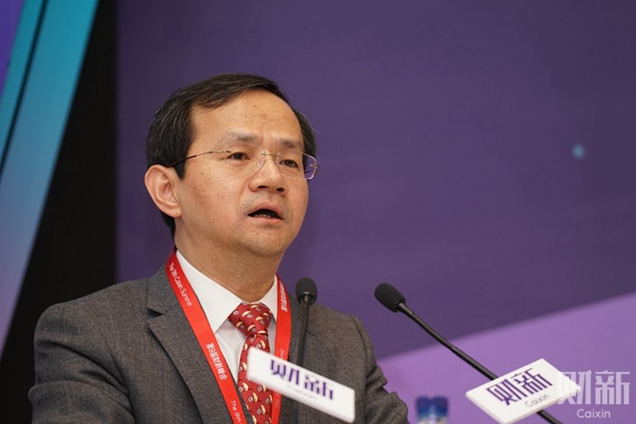 Beijing Deputy Mayor Yin Yong said that bailout funds for cash-strapped local companies focus more on financial investments than on strategic takeovers. Photo: Caixin