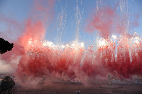 Daytime fireworks over Piazzale Michelangelo in Florence, Italy, on Sunday look like giant red waves. Photo: IC