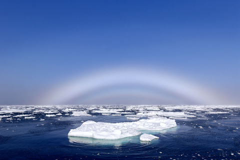 "A rare weather phenomenon called a ""fog bow"" appears over the ice floes in the Arctic Ocean in Norway. The spectacle, also known as a white rainbow, is created when sunshine hits tiny water droplets in fog or mist. Photo: IC"