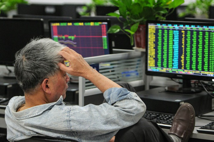 An investor monitors stock prices at a securities company in Jiujiang in China's central Jiangxi province on October 11. Photo: Bloomberg