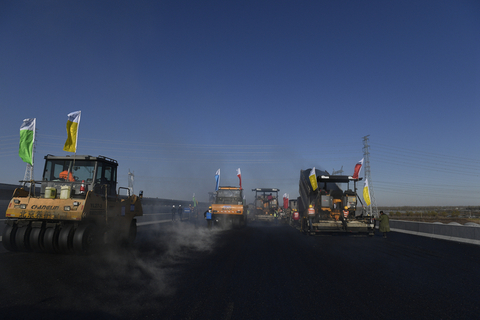 Heavy vehicles are being used to pave the road, which is scheduled for completion in the first half of 2019. Photo: VCG