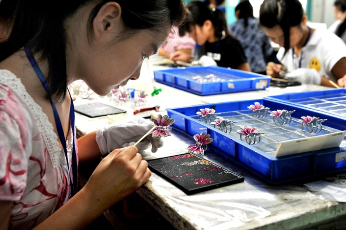 Workers manufacture jewelry at a Neoglory workshop in Yiwu, Zhejiang province in 2010. Photo: IC