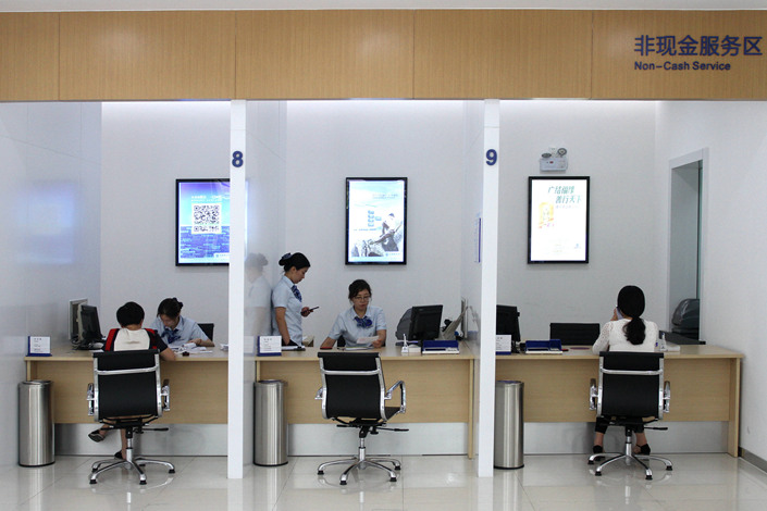 Customers in Wuxi, Jiangsu province, conduct bank business in August 2017. Photo: VCG